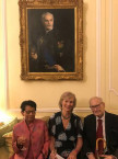 Paul and Jocelyn d'Orban with Sandra de Laszlo at the Residence of the British Ambassador to Budapest with the Portrait of Tibor Scitovszky